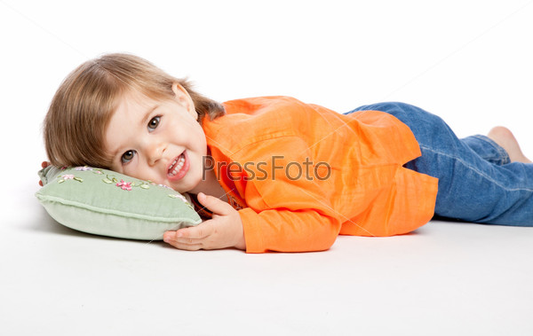 Little girl lying on the pillow