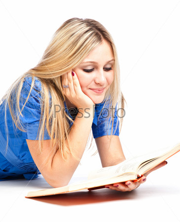 Girl laying on the floor and reading book