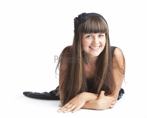 Beautiful smiling girl lying on floor