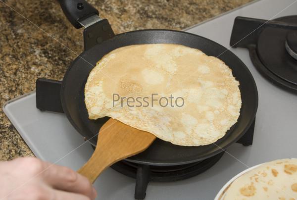 Fried pancake on a frying-pan