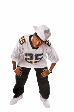 Young hip-hop dancer standing on white
