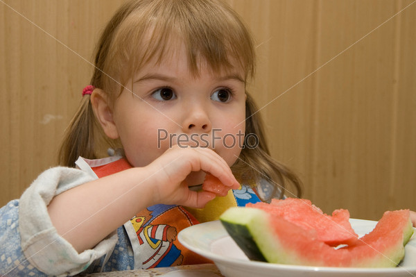 A little girl with watermelon