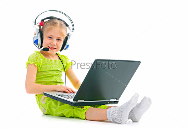 child in headphones with laptop
