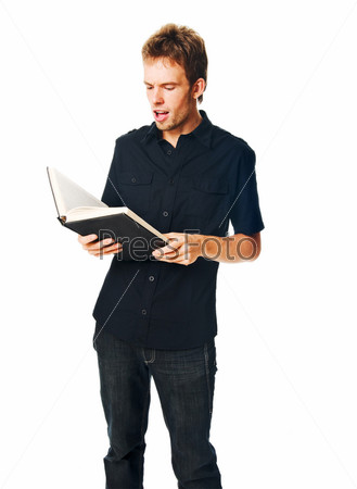 Young man with book on white