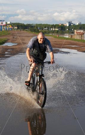 biker crossing the water