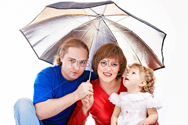 happy family under umbrella