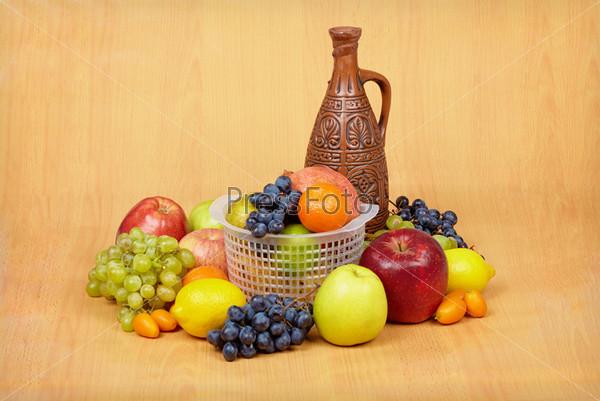 Still life of fruit and ceramic bottle