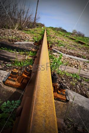 Old rusty rail - the railway leaving afar