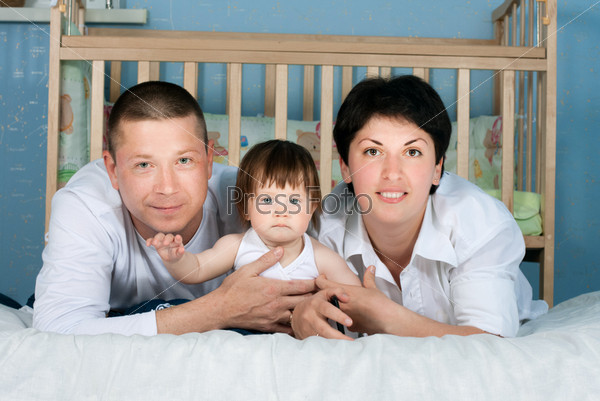 family home - father, mother and little daughter