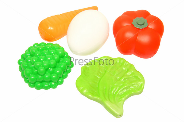 Фотография на тему Пластиковые овощи на белом фоне