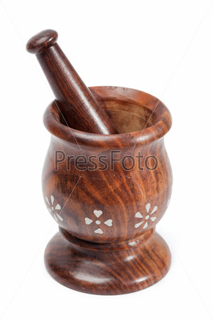 Wooden mortar and pestle isolated