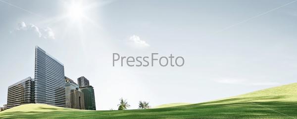 Абстрактный пейзаж с небоскребами на зеленом поле