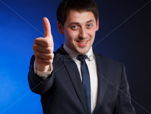 Man gesturing success sign