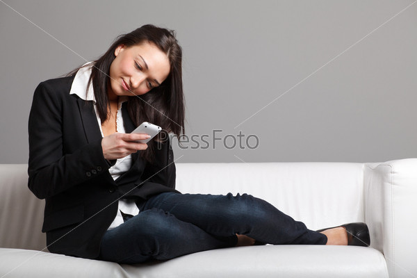 Young woman reading sms