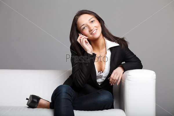 Young woman talking over the phone