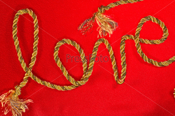 gold thread on red satin