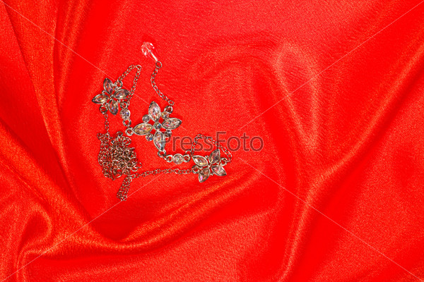 expensive jewelry on red satin