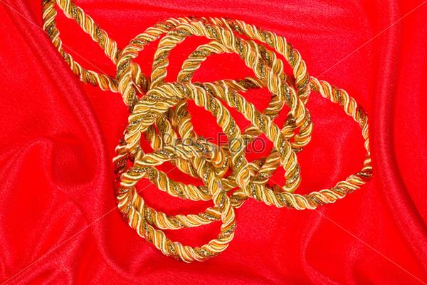 gold thread on red satin