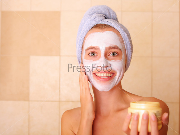 Beautiful woman puts on the face a mask