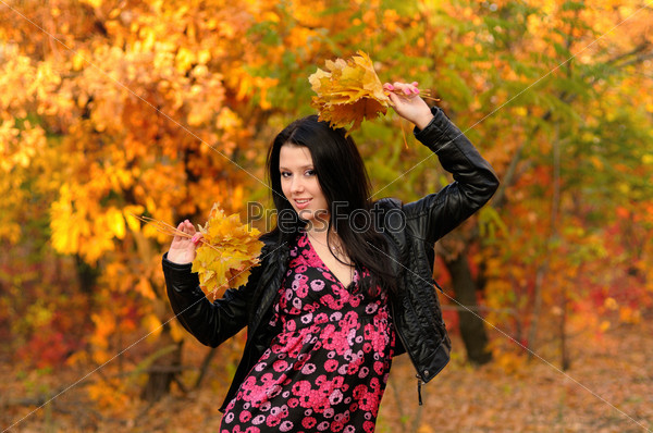 The girl brunette in autumn wood