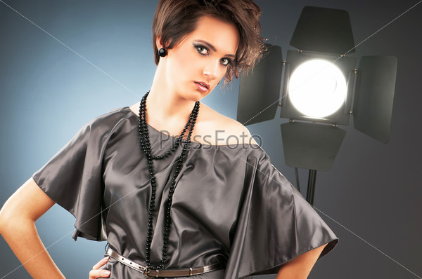 Young attractive girl with in the studio shooting