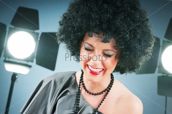 Young attractive girl with afro curly haircut