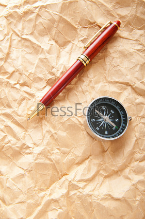 Vintage compass on the paper in adventure concept
