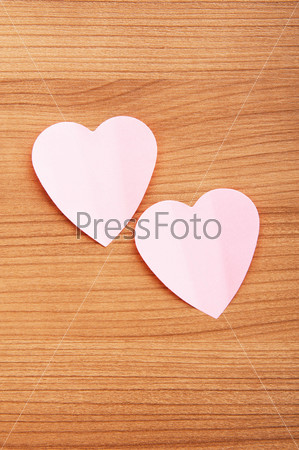 Heart shaped sticky notes on the background