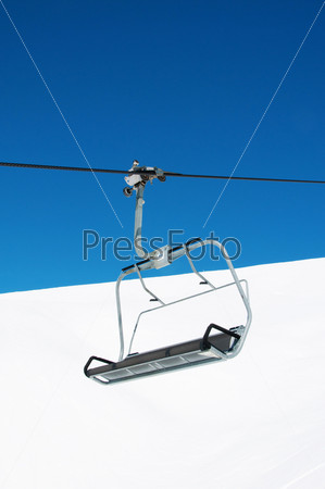 Ski lift chairs on bright winter day