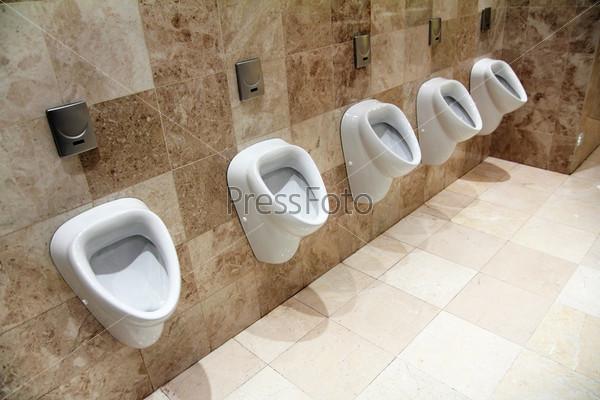 urinals in restroom