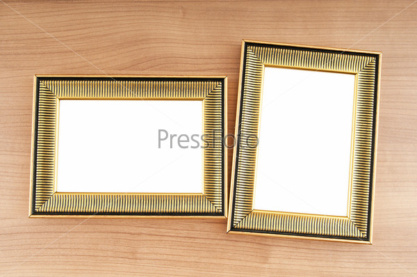 Picture frames on the polished wooden background