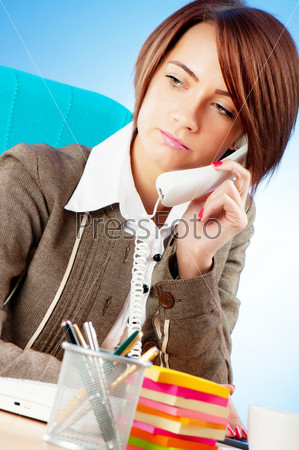 Young businesswoman talking on the phone