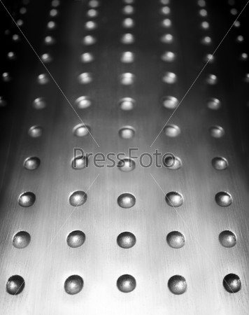 metal surface background with holes