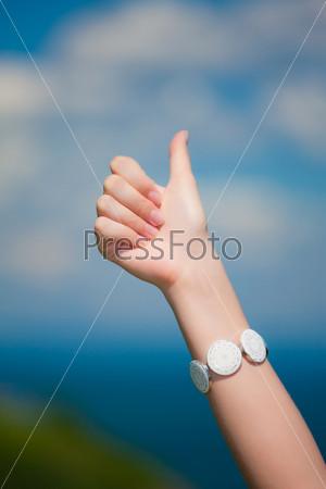 female hand with a skyline
