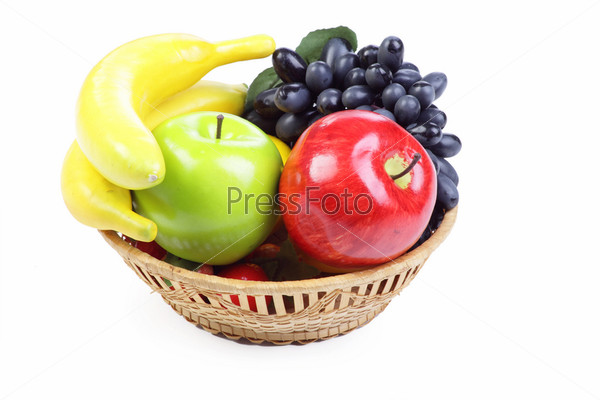 Fruit basket isolated on the white background