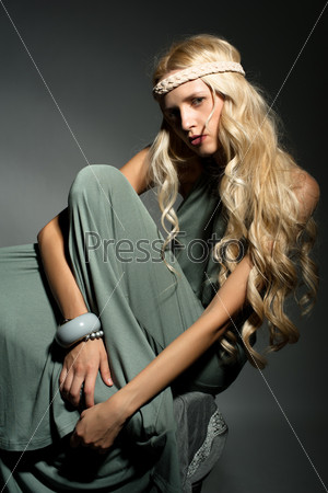 The blond girl on a gray background