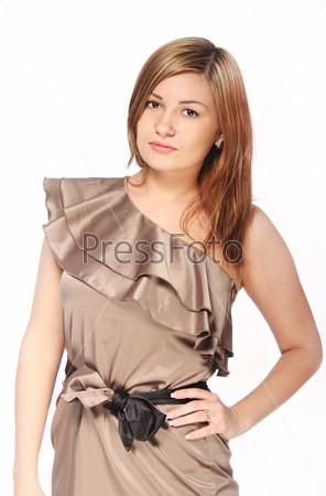 Girl in the beautiful dress in studio