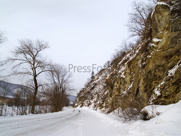 Winter road at a mountain slope