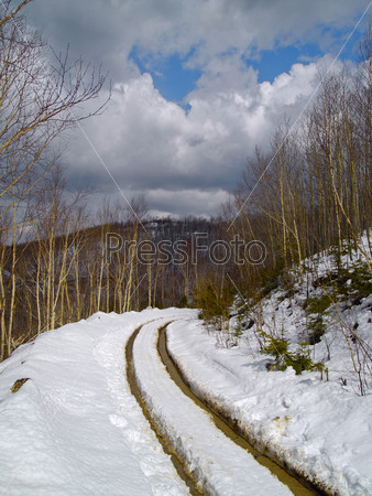 Thawing snow on mountain road