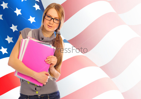 Portrait Of Pretty Young Woman Holding Book In Her Arms Usa Fla