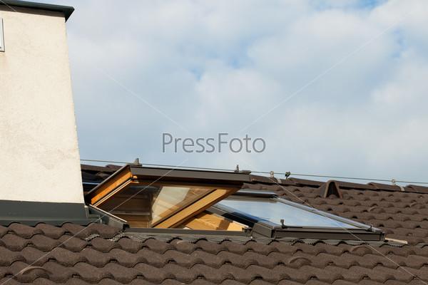 tiled roof and dormer windows on the skyline. Black Bedroom Furniture Sets. Home Design Ideas