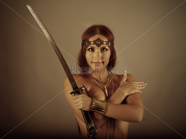 woman holding sword - 600×449