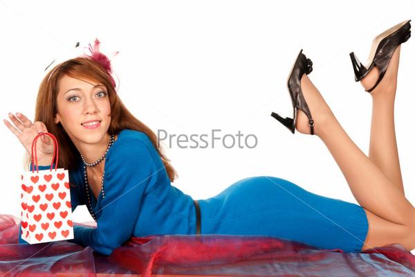 Фотография на тему Молодая женщина с пакетами, изолированная на белом фоне