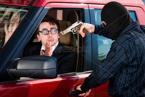 Ограбление бизнесмена в своем автомобиле
