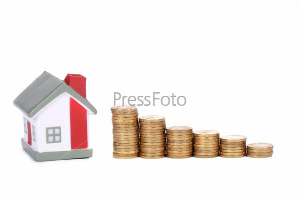 Модель дома и монеты в виде диаграммы