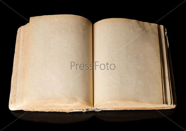 Фотография на тему Старая книга, изолированная на черном фоне