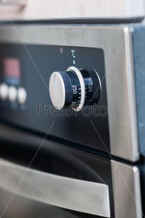 Фотография на тему Ручки и кнопки современной плиты