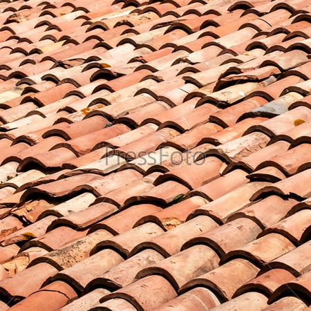 Фрагмент черепичной крыши в качестве фона