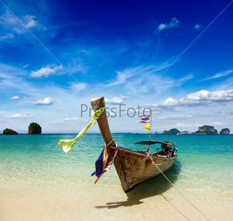 Фотография на тему Лодка на тропическом пляже, Таиланд