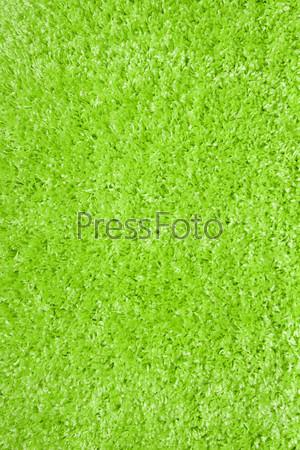 Фотография на тему Зеленый ковер из искусственного материала